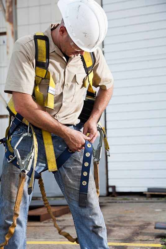 Worker Adjusting his Safety Equipment